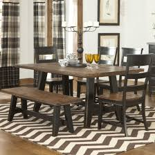 black polished wooden base legs dining table with rectangle iron carved black stained wooden based dining table with rounded light brown wooden countertop combined with 4 wooden benches