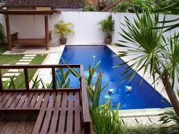 modern backyard with pool featured waterfalls pool ideas for