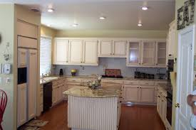 Painting Pressboard Kitchen Cabinets by Painting Oak Cabinets Before And After