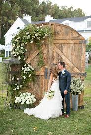 backyard wedding ideas white roses barn doors and backdrops