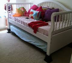 bedroom white wooden daybed with lath headboard and trundle