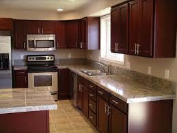 cherry wood kitchen cabinets with black granite knotty pine