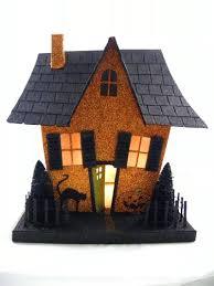 slanted roof halloween house flying witch bottle brush trees