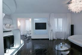 open living room with led tv black floor tiles white sofa and