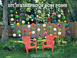 waterproof pom poms using dollar store plastic table cloths