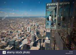 tourists in glass balcony skydeck observation deck view chicago