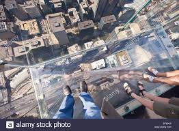 looking down through the glass balcony skydeck observation at the