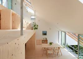 skylights and clerestory windows bathe the japanese re slope house