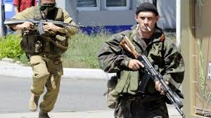 How far do EU US sanctions on Russia go    BBC News BBC Pro Russian separatist fighters in Donetsk     Jul