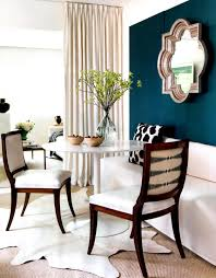 dining room round table with white seat chairs and dining
