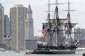 The USS Constitution passes