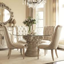 carved beige acrylic based dining table with round glass top