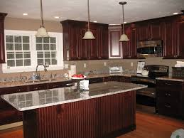 dark kitchen cabinets granite counter top but with hardwood floors