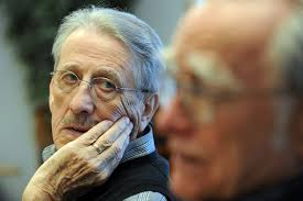 John Bayerl listens to fellow writing student Don Axon read his latest work during a writing class earlier this month at the University of Michigan's Osher ... - 030211_senior_memoir_john_bayerl-thumb-590x394-72355