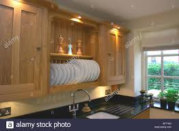Kitchen Cabinets Plate Rack Modern Gray Kitchen Features Dark Gray Flat Front Cabinets Paired