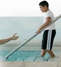 boy is baptized into JWs
