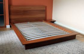 custom made platform bed with integrated night stand solid