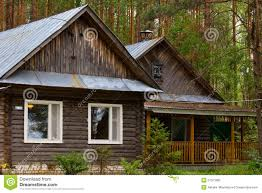 beautiful small house in the woods stock photo image 57521680