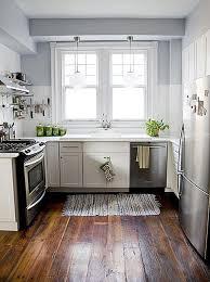 industrial kitchen design ideas with wooden floor and refrigerator