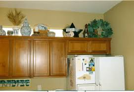 Kitchen Cabinet Top Decor by Decorations On Top Of Kitchen Cabinets Gramp Us