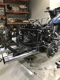 2016 triglide at a bike dealership attempting to install a lift