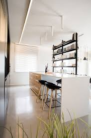 Small Penthouses Design by Delineating Space Effortlessly Urbane Penthouse Apartment In Israel