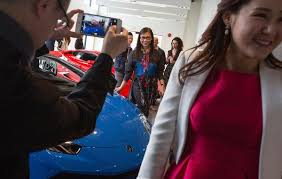 From left  Loretta Lai  Chelsea Jiang and Diana Wang attended a reception at a Lamborghini dealership last month in Vancouver  British Columbia Zero Hedge