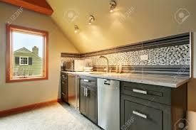dark green kitchen cabinets with back splash trim steel