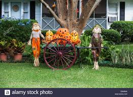 halloween display of pumpkin jack o lanterns and scarecrows on the