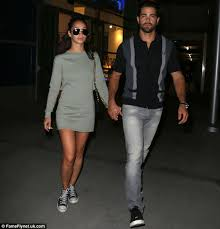 Leggy  Cara looked casual but sexy as in a short grey mini dress with Converse Daily Mail