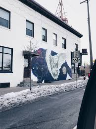 Wolf Mural by Amazing Wolf And Owl In Uptown Minneapolis Streetart