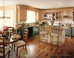 french country kitchen with bi colored cabinets and wrought iron