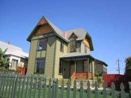 painted lady green button homes