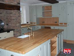 custom made kitchen units painted with oak trim