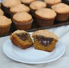 the table pumpkin cupcakes with chocolate filling and pumpkin