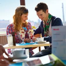 While on a date  a young couple enjoy dessert at a restaurant