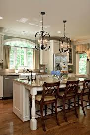 marble countertops chandelier over kitchen island lighting