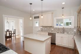 granite countertop floor ideas with white cabinets fasade