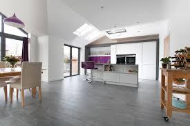 white cabinets purble backsplash bar stools and pendant light dark