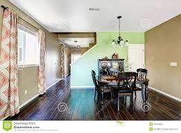 dining room with beige and green color walls stock photo image