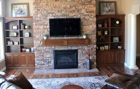 modish built in large tv cabinet beside fireplace mantel with