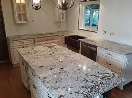 spanish kitchens with alderwood cabinets granite counters csi granite countertops in skokie il kitchen granite countertops are nicely matching beautiful white cabinets and creating some contrast