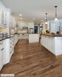 Flooring For Kitchen by Vinyl Plank Wood Look Floor Versus Engineered Hardwood Woods