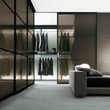 spacious and incredible walk in closet with clean lines shelving