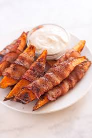 thanksgiving turkey wrapped in bacon baked bacon wrapped sweet potato fries a sassy spoon