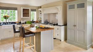 nice white farmhouse kitchen with large square kitchen island