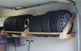 Rolling Wood Storage Rack Plans by How To Store Tires In The Garage Garagespot