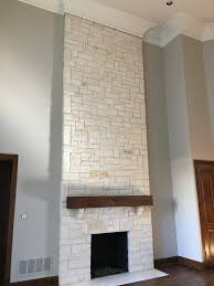 light cream stone for entry exterior and floor to ceiling for the