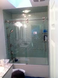 sliding frameless bathtub enclosure with visible tracks and wheels sliding frameless bathtub enclosure with visible tracks and wheels for a contemporary design we use
