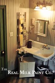 restored bathroom with beadboard walls painted with french gray